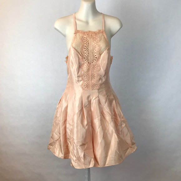 56adff84dfe0  FREE PEOPLE  Heart to Heart Romper in Pink